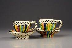 Tea cups and tea pots from http://juliaroxburgh.co.uk . Jester Tea Cups Gaudi Tea Cups Red and Black Spikey Tea Pot Mixed Patte...