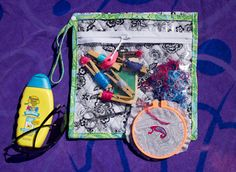 """Ready,Set,Go! ~ The """"You Can Take It With You"""" Embroidery Project Bag « Sew,Mama,Sew! Blog Very practical - one side has a see through zippered pocket for floss, needlebook, etc, and the other side has a simple see through pocket for your hoop"""