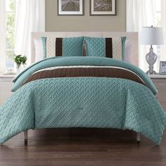 Bring a touch of texture and simple style to your well-curated ensemble with this eye-catching comforter set, the perfect piece for your welcoming guest suite or master bedroom. Featuring bold, embossed geometric trellis details, this piece brings a bit of texture and dimension to your look, while its aqua and brown color-block details brings a soothing touch of color to the space. Add it to a simple wood platform bed to let its patterns really pop, then add in cozy off-white or ivory cotton…