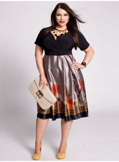 Only size 26/28 left :( With an exotic border print skirt and silhouette cinching high-waistband, this dress is an effortlessly chic way to work color-blocking this season. Create a ladylike look by wearing it with wedge sandals and an oversized clutch.