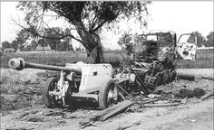 A destroyed RSO artillery tractor and PaK 40