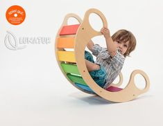 """The rainbow rocker is a """"play furniture"""" with lots of different ways to enjoy. Babies can be rocked softly, then turned around it can quickly become a tunnel to crawl through. Small kids can. Multipurpose Furniture, Childrens Rocking Chairs, Wood Toys, Kids Furniture, Big Kids, Kids Playing, Little Ones, Playroom, Kids Toys"""