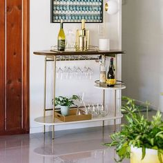 west elm's bar carts are the perfect solution for small spaces. Find modern bar carts and cabinets that provide modern style to the kitchen or dining room. Bar Cart Styling, Bar Cart Decor, Bar Console, Gold Bar Cart, Brass Bar Cart, Metal Bar Cart, Indoor Bar, Metal Tree Wall Art, Bar Furniture