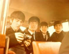 The Beatles in a car