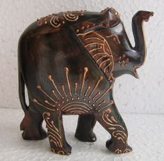 Wood Elephant figurine Handmade Statue Handcrafted Sculpture Carved Painted. $25.00, via Etsy.