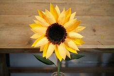 This listing is for 1 Handmade Paper Sunflower. Each stem has 2 leaves, black/brown center, and is approximately 8 in diameter and 15 from bottom
