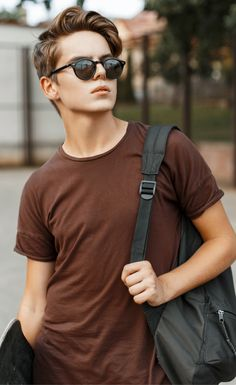 Men's Summer fashion street style 2017. Get this classy look featuring plain t-shirt, bag, and sunglasses.