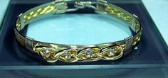 4 Wire Bracelet with 14kt Gold Plate Solitaire Diamond Focal on Etsy, $24.95