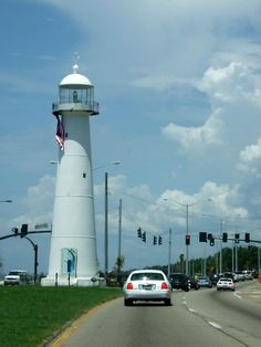 Oh, yes, the cars just drive by this lighthouse in Biloxi.