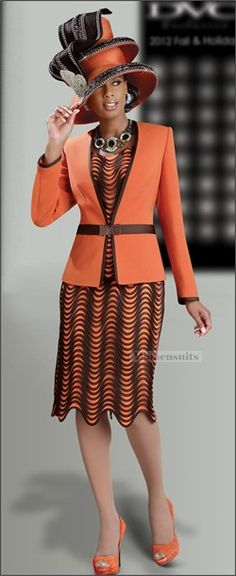 """Designer DVC Exclusive Description Orange is one of fashion's most important Fall colors. DVC teams it up with a rich brown trim for a truly eye-catching outfit. The front of the camisole and 28"""" slim skirt are entirely covered in a wave-like pattern made of satin spaghetti.    The pretty orange microfiber 25"""" jacket is trimmed with brown satin and closes at the waist with a rhinestone buckle. Imported Fabric. Dry Clean Only. You Receive 3 Piece Set Includes Jacket, Cami and Skirt"""