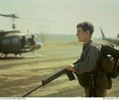 Private Peter McCann of Peterborough, SA, waits at the 1st Australian Task Force (1ATF) as US helicopters prepare to lift troops of 3rd Battalion, The Royal Australian Regiment (3RAR), to the Long Hai Hills, south of Nui Dat. The mission, Operation Pinnaroo, is still in progress.   8th March, 1968.