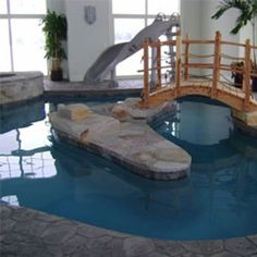 Indoor Pool with island and water slide   #BarringtonPools