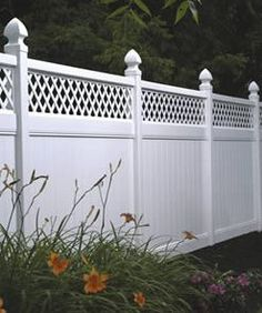 If we ever fence the yard, I really like the look of this vinyl fence.