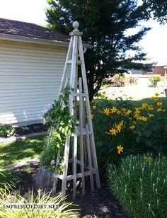 20+ Ways to create vertical interest in the garden with arbors, trellis, obelisks, and more. Wooden obelisk.
