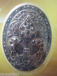 NEW! FLEUR DE LIS RHINESTONE DESIGNER CANDLE PINS WOULD MAKE ANY CANDLE AND ROOM BEAUTIFUL. MEASURES APPROX. 3 3/4 INCHES TALL BY 2  INCHES WIDE REALLY PRETTY!! COLOR IS BRONZE WITH BLACK RHINESTONES.