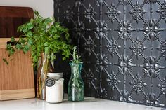 """I love bits of black to pop,"" Rachel says, ""like the kitchen splashback, which is pressed metal painted in matt black."": [object Object]"