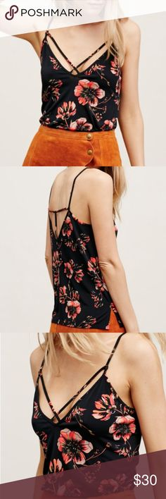 Free People floral strappy tank Super cute Free People floral print top with strappy detail and a stretchy fit, 95% polyester 5% spandex. Runs slightly big fitting closer to a small. No trades. Free People Tops Tank Tops