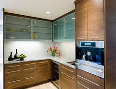 Frosted glass cabinets leave a bit mystery thanks to the translucent look 28 Kitchen Cabinet Ideas With Glass Doors For A Sparkling Modern H...