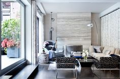 This vein-cut marble slab creates a beautiful and simple accent wall when used from floor to ceiling on the fireplace chimney.