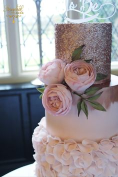 Rose gold sequins and pink ruffles make a great combination for a pretty wedding cake.