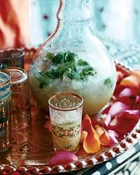 sweet lime-ginger rum punch.    2/3 c water  1/2 c sugar  2 tbsp minced fresh ginger  3/4 c fresh lime juice  2 c dark rum  2 c ice  lime slices and cilantro for garnish