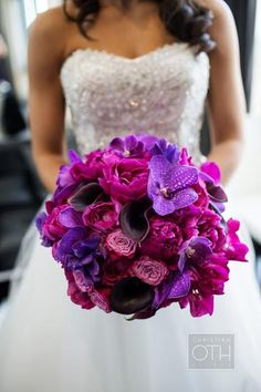 This Beautiful Bridal Bouquet stands out from the crowd! Featuring purple Vanda Orchids, Plum Calla Lilies, and Magenta Peonies. Arranged by #BelleFleurNY and captured by our friends at @christianoth