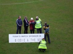 On the pitch before the match against Frome Town Nigel Biddlecombe signs Weymouth FC over to the community of Weymouth