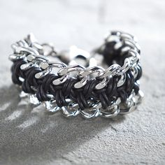Lisa's Silver Chain And Leather Bracelet from Uno Alla Volta on shop.CatalogSpree.com, your personal digital mall.