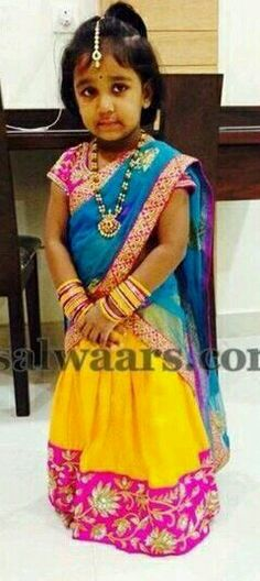 Cute girl in yellow and blue half saree.......