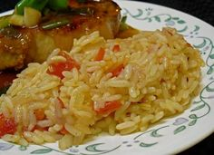 Portuguese Rice: 1 yellow onion, finely chopped   3 garlic cloves, minced   3 cups long grain white rice, washed and drained   4 cups boiling water   1 bay leaf   2 medium tomatoes, chopped   http://www.foodnetwork.com/recipes/emeril-lagasse/portuguese-rice-recipe/index.html