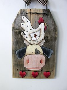 Chicken sitting on top of Cow Head Hand by barbsheartstrokes