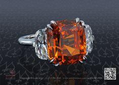 Three stone ring with 13 carat mandarin garnet by Leon Mege....adore adore adore