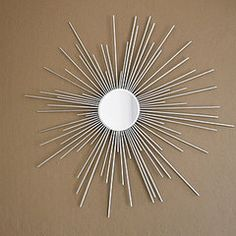 DIY Dollar Store Starburst Mirror ... If you want you can use metal skewers then no need to paint. Use a concave , convex or beveled mirror for something different.