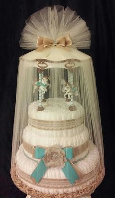 IV-Tier Dream Baby Carousel Diaper Cake desgned for that rustic themed country style baby shower!!! @Auniquedesignergiftbasket.com reneelenn2692@gmail.com