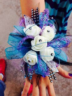 Keepsake corsage in turquoise, purple, silver, and black!