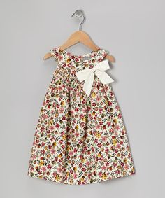 Classic and charming, this pretty dress has a roomy swing cut that's perfect for any affair. Details like its smocked yoke neckline, floral print and beautiful bow make it a friendly, fashionable piece for little ladies everywhere.CottonMachine washImported