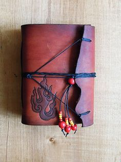 leather notebook fire by PairOfHandsLeather on Etsy
