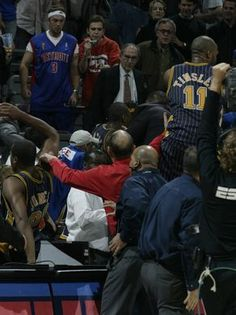 The Indiana Pacers go into the stands behind the scorers