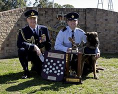 Military Working Dogs Around the World   Chief of Air Force, Air Marshal (AIRMSHL) Mark Binskin, AM (left), Aircraftman (AC) Jack Treloar and Military Working Dog (MWD) E-Dog with AC Treloar's awards. AC Treloar won both the J. B. Teirnan Police Qualities Award and Dux of the course.    The Royal Australian Air Force (RAAF) is celebrating 50 years of military working dog training with the Graduation Parade of the Air Force's newest Military Working Dogs and their handlers on Thursday 31…