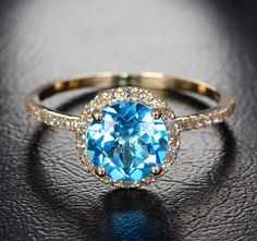 Natural 7mm Blue Topaz .22ct Pave Diamonds 14K Yellow Gold Halo Engagement Ring on Etsy, $399.00