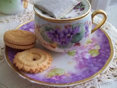Limoges - lovely cup and saucer... one of my many collections is of tiny purple violet chinaware.  These are beautiful pieces.