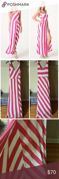 """bebe Logo Pink/White Striped Maxi Dress bebe logo pink/white striped maxi dress. Excellent condition. Glittering logo in Swarovski crystals. Wrap style dress. NOTE: the slit goes all the way up (see model in 1st pic).  Perfect for a summer day on the beach.  Pair with some cute flats. Measurements laying flat: bust 14"""" (armpit to armpit), waist 12"""", hips 16"""", center back to hem 49"""", from shoulder to hem 54"""". Reasonable offers welcomed. Please keep in mind that POSH takes 20% of my sale so…"""
