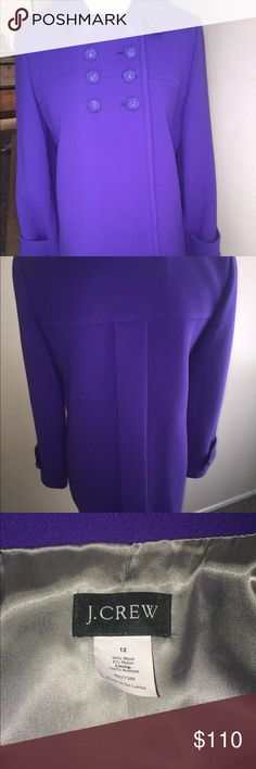 J crew peacoat J. Crew Coat Size 12  Gorgeous coat in a vibrant purple. Double breast button detail at top  Button closure Embossed raised crest buttons 2 button tab sleeves 2 front side slip pockets Pleat back detail Coat is 94% wool, 6% nylon with 100% acetate lining Comes from a pet and smoke free home J. Crew Jackets & Coats Pea Coats