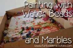 Fun Toddler Activities: Painting with water beads and marbles!
