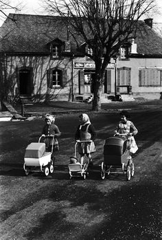 prams-I actually pushed my 3 little brothers in one of these when we lived in England in the 60s.  Later, us kids made a go-cart of of the pram.