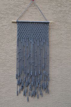 Wall panels handmade macramé technique. Material: 100% polyester. Color: light gray. Strap: natural wood - pine. Dimensions: The length of the strap to the bottom, including the thread - 84cm / 33,1 inches Width - 33cm / 13 inches