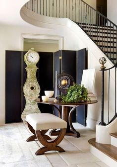 Not-So-Basic Black. The portfolio of Atlanta-based Robert Brown Interior Design is practically a study on how to beautifully incorporate black accents. We love how the black screen with nailhead detailing provides the perfect backdrop for the Gustavian clock, taking a piece that would already draw the eye and making it utterly unmissable.