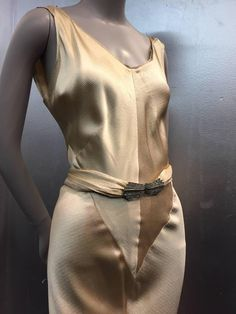 A divine 1930s champagne gold hammered silk satin bias-cut Art Deco evening gown with wrap-back and rhinestone belt buckle detail. Low, low plunging back and genius seaming throughout