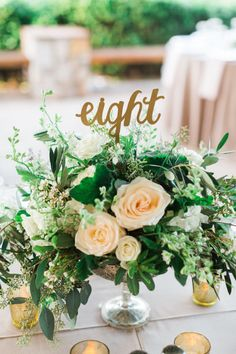 greenery centerpiece with minimal flowers, alternate view