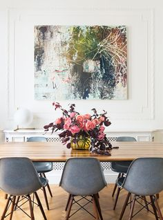 stunning architecture, modern furniture, and statement-making art and florals in the dining room